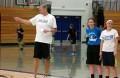 Former Wisconsin Badger Basketball star Brian Butch watches over athletes attending Thursday's camp,  inlcuding Bluejay varsity athletes Maddix Bonnell and Chelsey LaMonica (right)