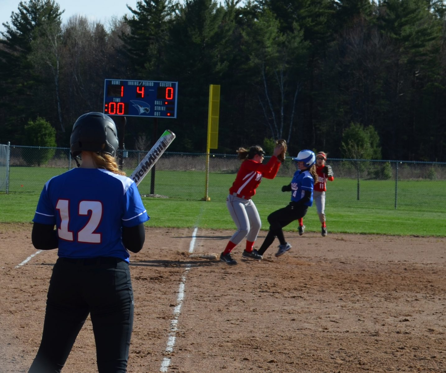 Maddix Bonnell avoids the tag as she steals third base.