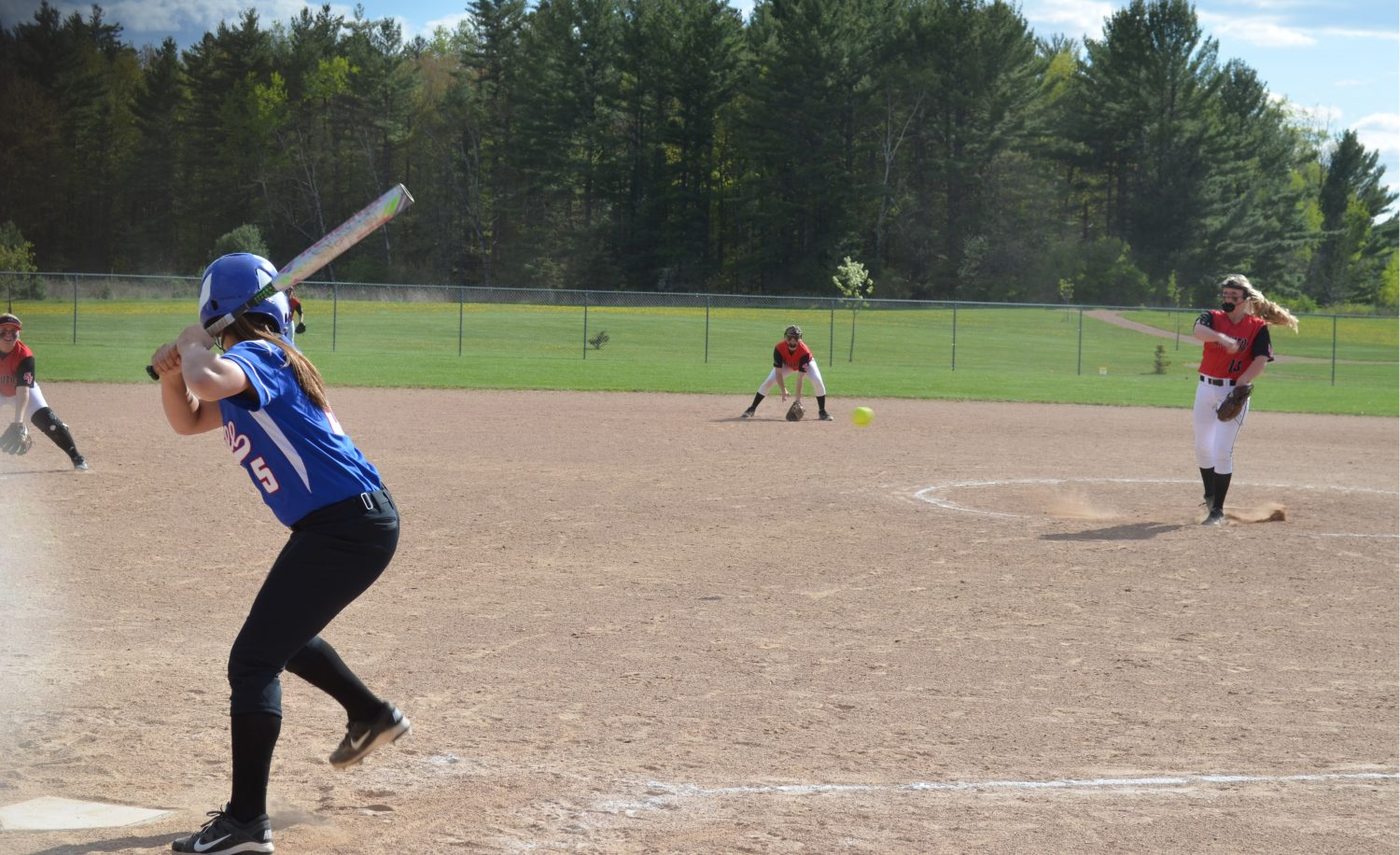 The ball is pitched to Kelsie Belfiori. She would hit a hard grounder straight to the pitcher's knee.
