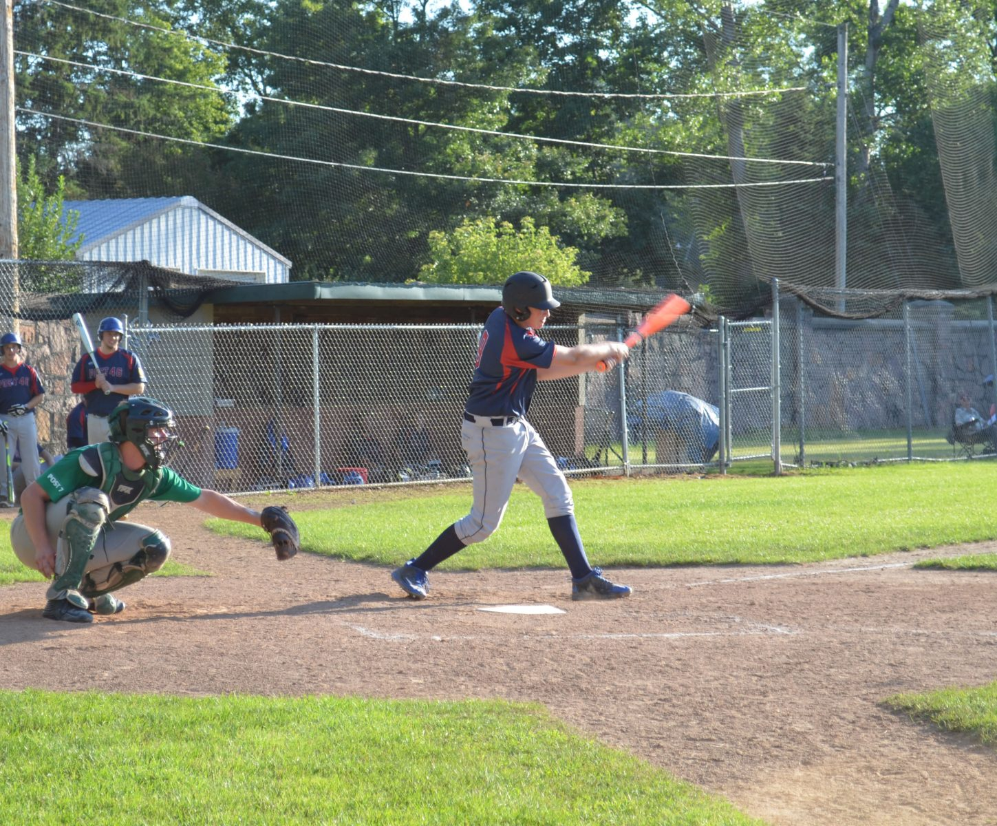 Trey Seubert hits a line drive to center during the Merrill-Rhinelander game.
