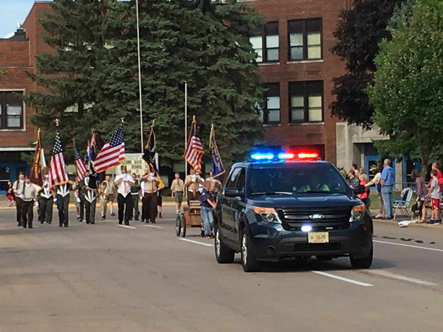 Merrill Police Chief Ken Neff leads the procession past Prairie River Middle School Monday morning.