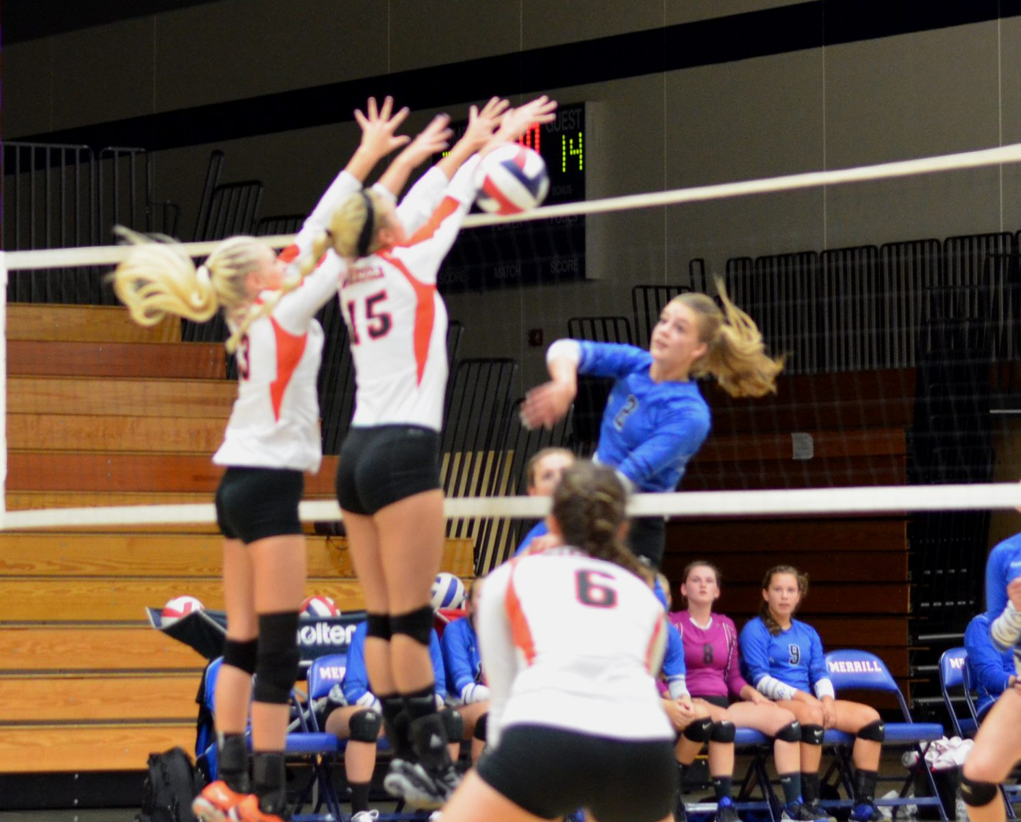 Junior Morgan Wardall fires the ball right past the middle blocker for a kill against Marshfield.