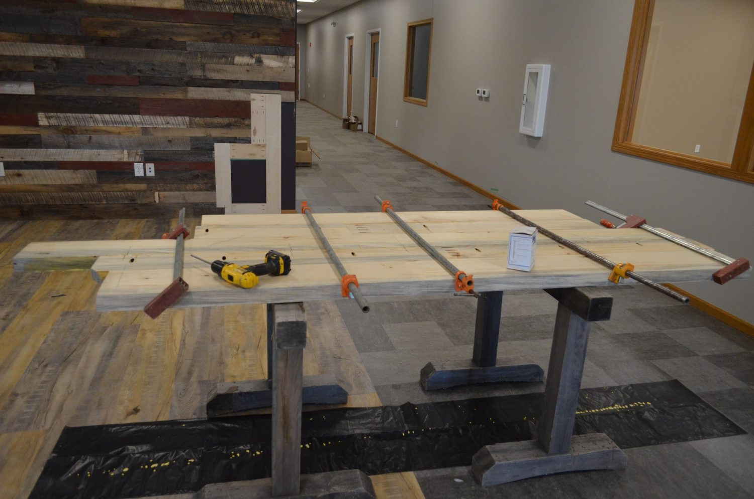 A customer service desk in the works for the new Merrill Community Enrichment Center, made of barn wood.