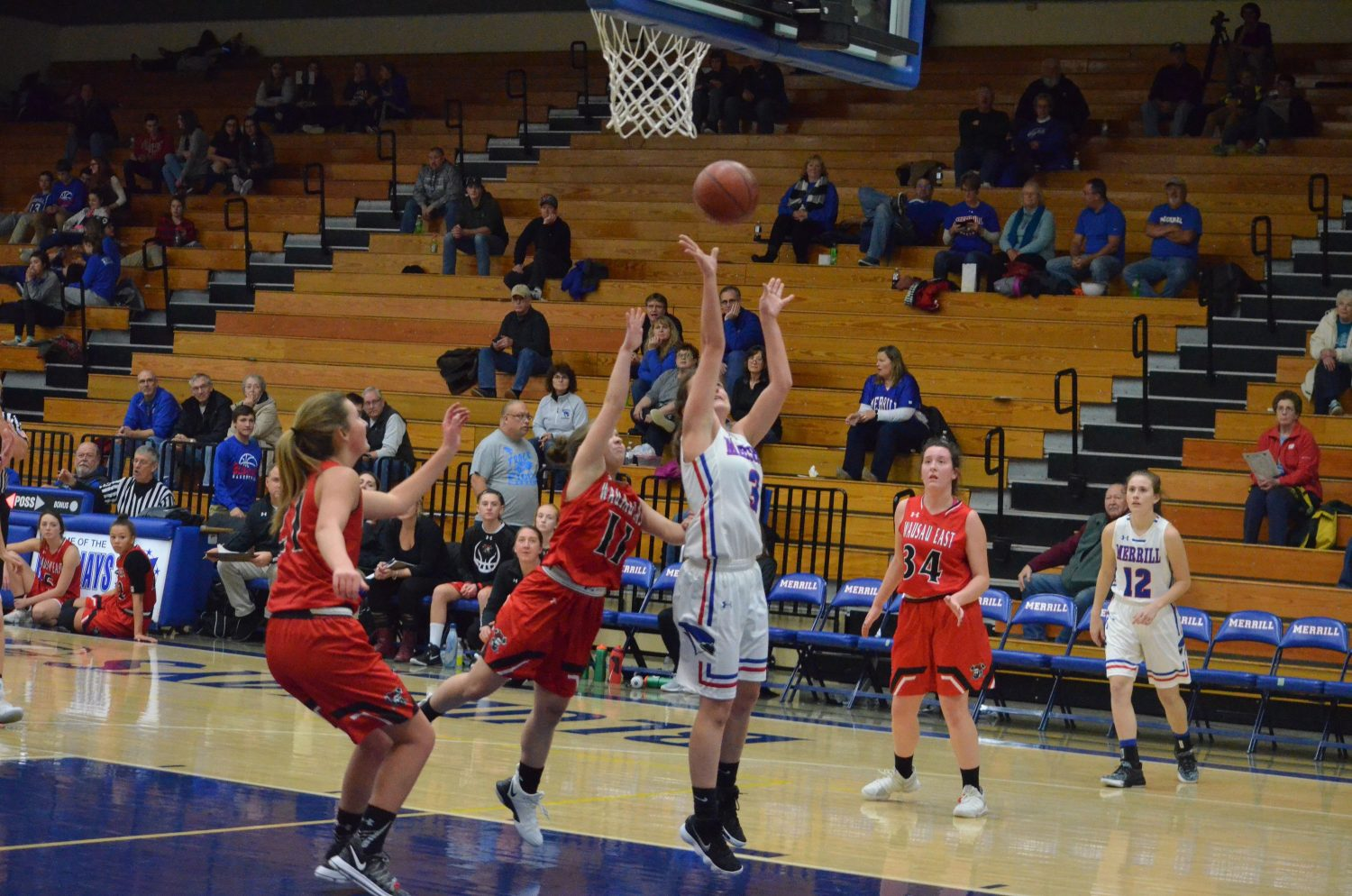 Pictured is Maddix Bonnell as she makes a layup after Madi Weix dishes her the ball.